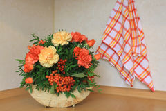 Floristic composition with autumn flowers and berries. Floristic composition made on the wood Royalty Free Stock Image