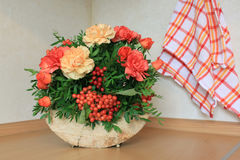 Floristic composition with autumn flowers and berries. Floristic composition made on the wood Royalty Free Stock Photography