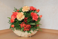 Floristic composition with autumn flowers and berries. Floristic composition made on the wood Stock Photos