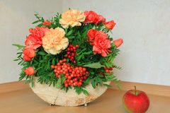 Floristic composition with autumn flowers and berries. Floristic composition made on the wood Stock Image