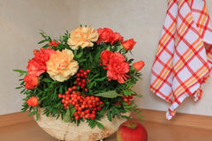 Floristic composition with autumn flowers and berries. Floristic composition made on the wood Royalty Free Stock Photo