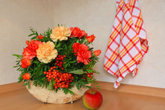 Floristic composition with autumn flowers and berries. Floristic composition made on the wood Stock Images