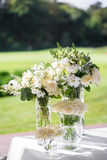 Floristics Decorations for the wedding ceremony. Flowers closeup. White flowers with green leaves, white wedding, exit ceremony, wedding in nature, floristry Royalty Free Stock Photo