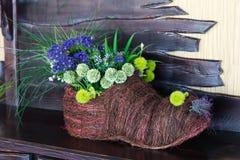 Floristische Zusammensetzung im Stiefel der Stangen Lizenzfreie Stockbilder