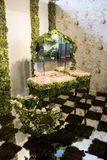 Floristry display. With mirror and desk with flowers Stock Photography