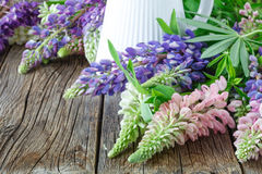 Floristry workshop wooden table with decor. Decorative artwork from spring flower Stock Photo