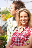 Florists. Young smiling people florists working in the garden Royalty Free Stock Photo