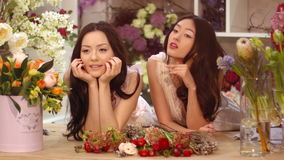 Florists. Asian women happy working in flower store. Florists. Florists. Two asian women happy working in flower store indoors. Playful fashion models in tender stock video