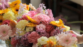 Florists decorate the room with flowers. Such as roses, chrysanthemums, carnations, tulips, lilacs stock footage