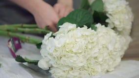 Florists decorate room. Florists prepare fresh floral arrangements