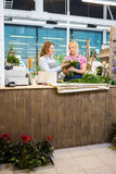 Florists Making Bouquet In Flower Shop Stock Photos