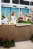 Florists Making Bouquet In Flower Shop Stock Photos