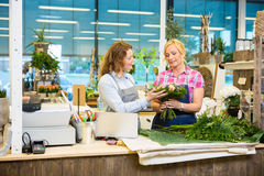 Florists Making Bouquet In Flower Shop Royalty Free Stock Photos