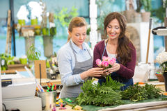 Florists Making Bouquet Of Roses In Shop Stock Photography