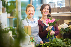 Florists Making Bouquet Of Roses In Shop Royalty Free Stock Photo