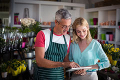 Florists using digital tablet in florist shop Stock Photography