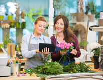 Florists Using Digital Tablet While Making Bouquet Stock Photography