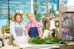Florists Using Laptop In Flower Shop Stock Photography