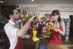 Florists Working Together In Flower Shop Stock Photography