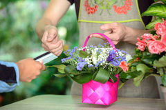 Florists. Young men working as florist giving credit card to customer after purchase Stock Photography
