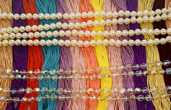 Floss with beautiful multi-colored pearls and beads Royalty Free Stock Images