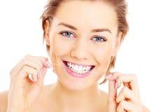 Flossing dei denti Fotografia Stock