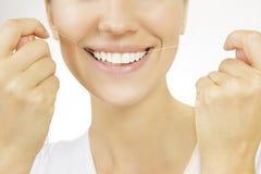 Flossing, Vrouw en tandenzijde stock foto's