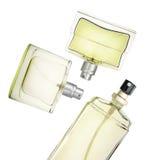 Flotación de las botellas de perfume Foto de archivo libre de regalías