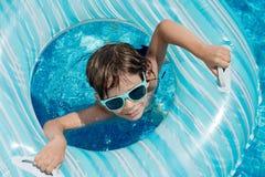 Flotador de la piscina del niño Imagen de archivo