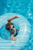 Flotador de la piscina del niño Fotografía de archivo libre de regalías