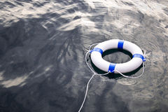Flotador del ahorrador de vida marina en el mar Fotos de archivo libres de regalías