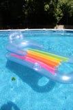 Flotador en la piscina Imágenes de archivo libres de regalías