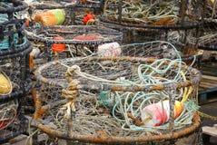 Flotadores anaranjados y amarillos del cangrejo imagenes de archivo