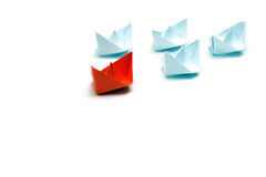 Flotilla. Of the paper ships led by the red ship Royalty Free Stock Image