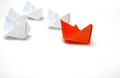 Flotilla. Of the paper ships led by the red ship Royalty Free Stock Photo