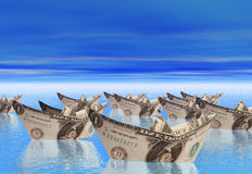 Flotilla. A Flotilla od paper boats made from dollar bills Stock Photos
