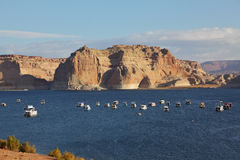 Flotilla of elegant white yachts. On Lake Powell. Small waves on the lake from the evening breeze Stock Photos