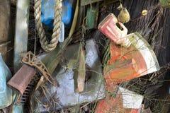 Junk littering ocean beach Stock Image