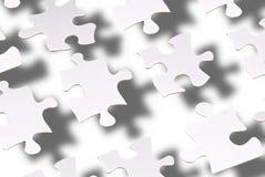 Flottement de parties de puzzle photo stock