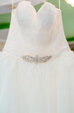 Flounces of delicate textile wedding dress hanging Stock Photography