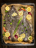 Flounder fish with fresh seasoning,lemon and spices on baking pan Stock Photography