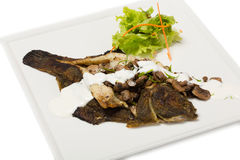 Flounder fried with mushrooms Royalty Free Stock Images