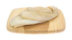 Flounder Raw On Cutting Board Side View Stock Photography