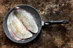 Flounders in a frying pan Stock Photography