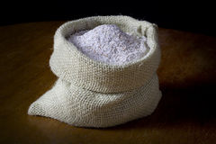 Flour. Wholemeal flour in jute sack Stock Photos