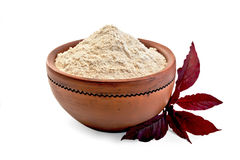 Flour amaranth in clay bowl with purple flower Stock Photography