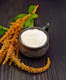 Flour amaranth in clay cup on board Royalty Free Stock Images