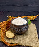 Flour amaranth in clay cup with flower on dark board Stock Photos