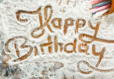 Flour Artwork With Handprints birthday. Flour Artwork With Food And Handprints, Fun background with the words HAPPY BIRTHDAY and human handpints in scattered Royalty Free Stock Image