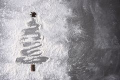Flour on a baking sheet in a Christmas tree shape Stock Images